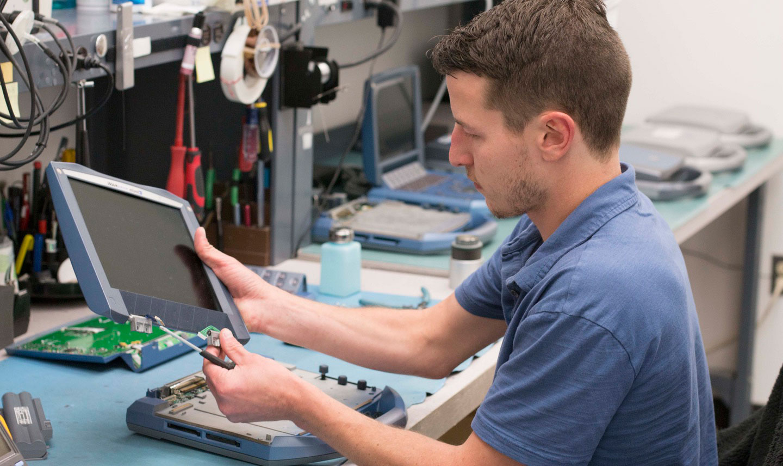 TEchnician fixing ultrasound machine monitor