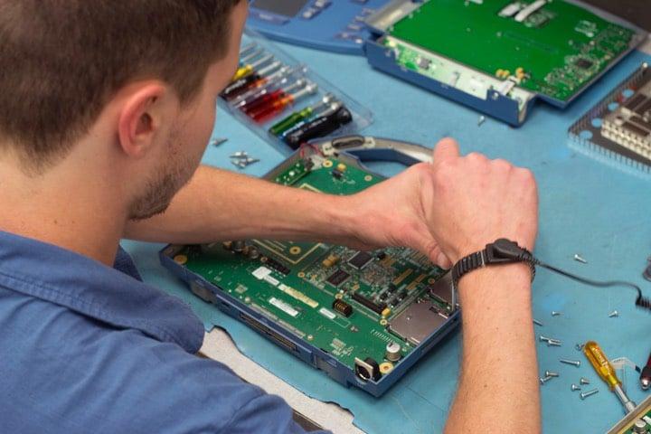 Man fixing ultrasound motherboard
