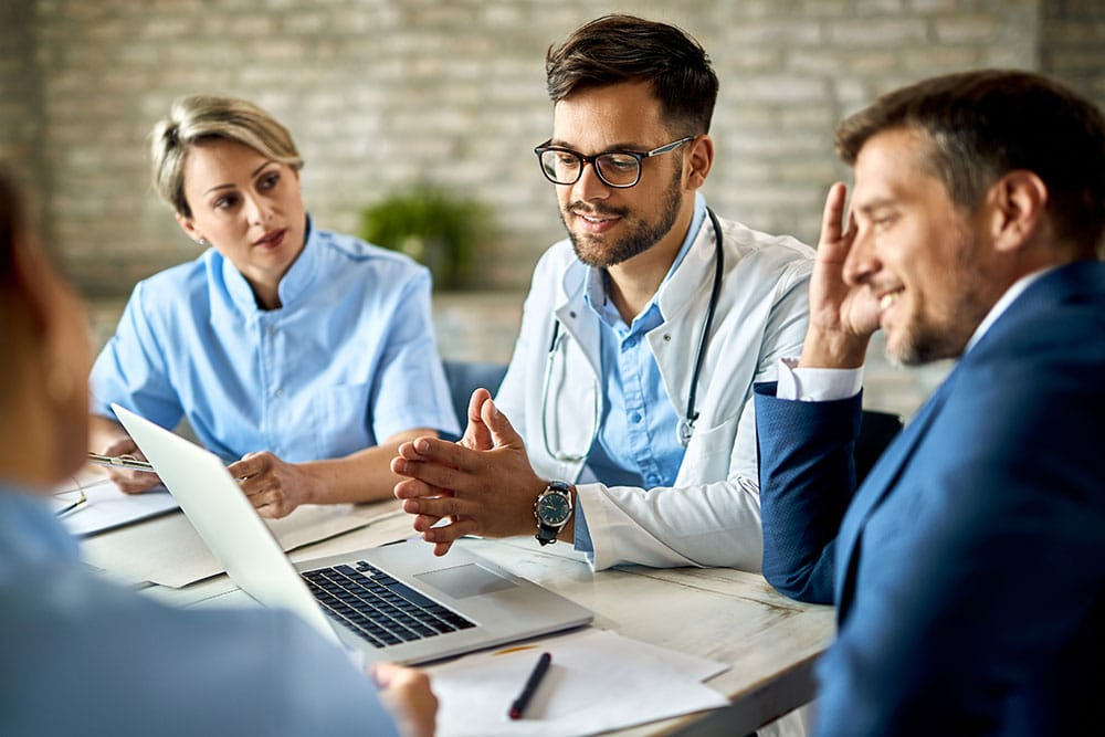 Group of healthcare workers and businessman having a meeting
